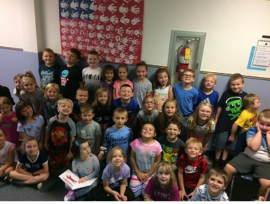 Ms. Farabaugh and Mrs. Barto's class pose for a picture together.