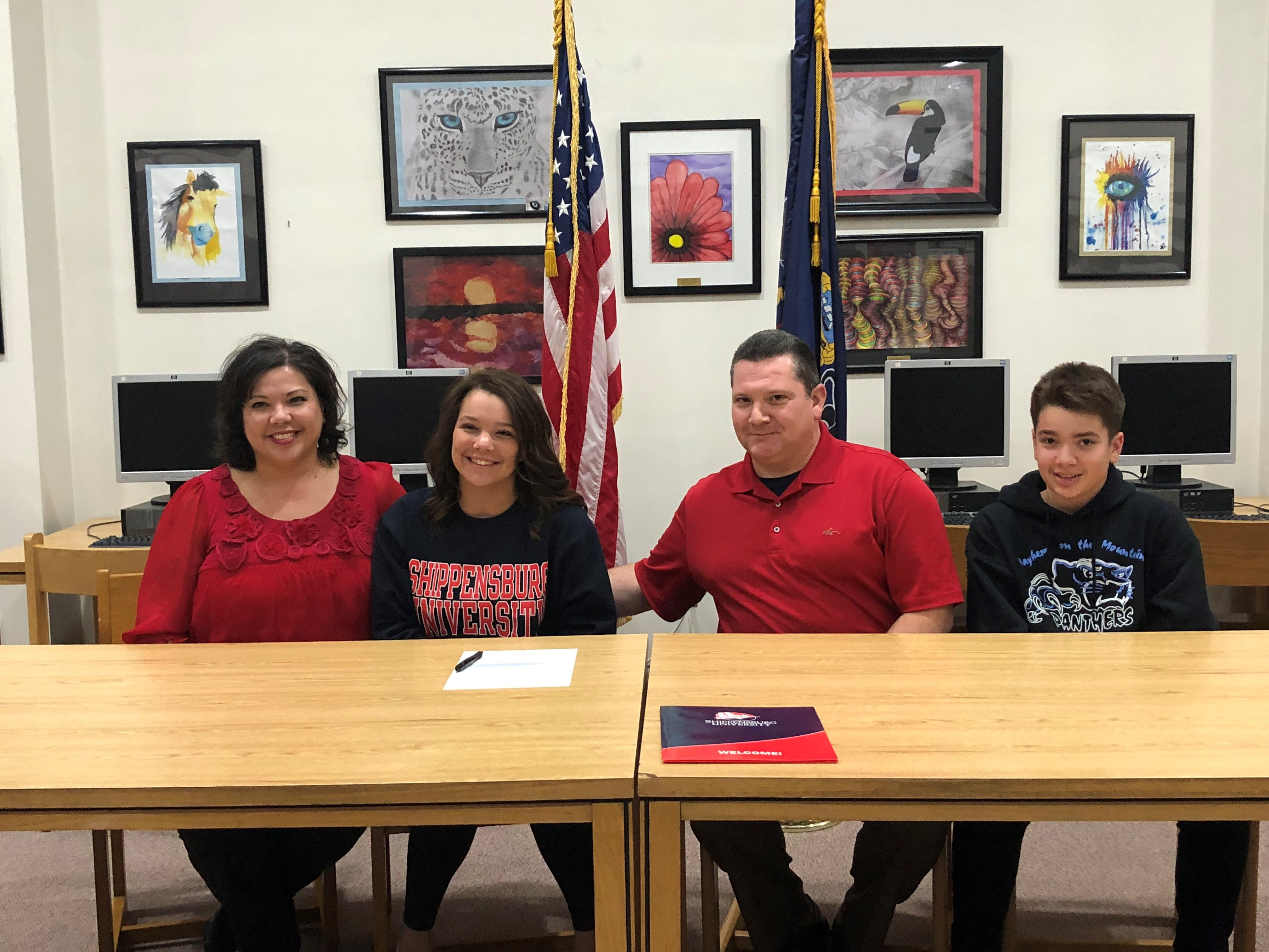 Madison signing with Shippensburg University for swimming.
