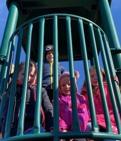 Kindergarten students enjoying a warm sunny day of outside recess.