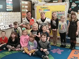 PCHS FOOTBALL PLAYERS READ TO THE STUDENTS FOR READ ACROSS AMERICA DAY