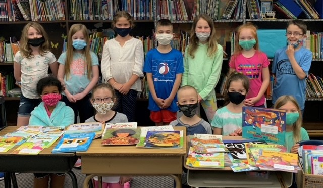"""Library """"Read to Succeed"""" books. Each child at PCP got to pick a book this week during Library class to keep."""